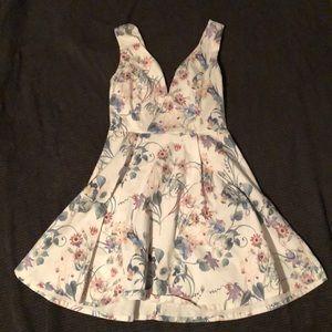 White floral flirty dress
